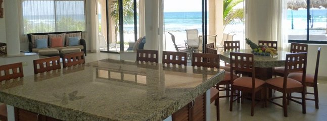 Granite kitchen island and table seats 14.
