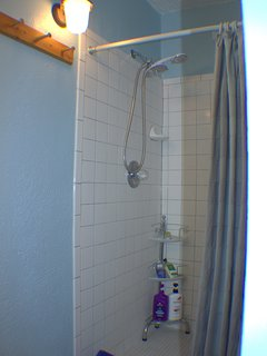 The shower is pretty spacious for one person and the shower is high enough for even taller folks.