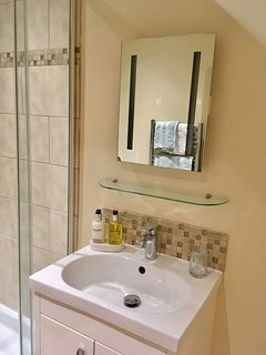 vanity basin with sensor mirror and mosaic tiling