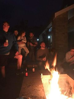 Friends & family gathering round the huge new fire pit at Woodpecker cottage.