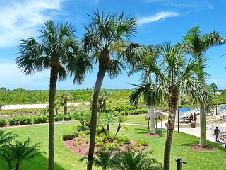 Relaxing beachfront condo w/ heated pool in a tropical garden setting