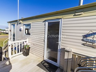6 Berth caravan at California Cliffs, decking close to beach. Ref 50018 Heron