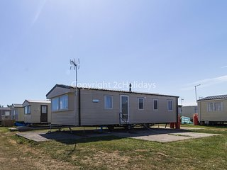 8 berth caravan with D/G, C/H and a field view. At Martello Park. REF 29128B