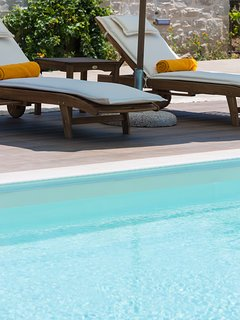 Enjoy the Greek sun and let the cool breeze take all your worries away!