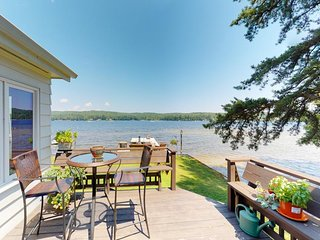 NEW LISTING! Lakefront home w/docks, deck, firepits, paddle boat, dogs OK