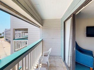 NEW LISTING! Breezy oceanview condo with balcony & shared hot tub and pool!