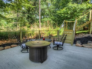 Lower level patio with fire pit and seating