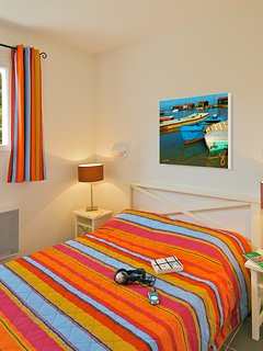 The bedroom features a cozy Double bed.