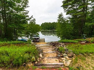 NEW LISTING! Spacious lakefront home w/screened-in porch,  jet tub & firepit