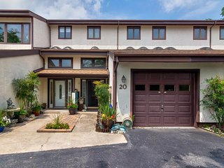 NEW LISTING! Gorgeous, renovated townhome w/shared pool, St. Martin's River view