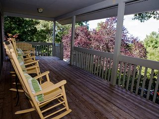Sit back & relax on one of the front porch rockers
