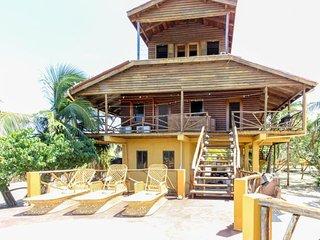 Unique waterfront villa w/ a private balcony & pool deck - walk to the beach!