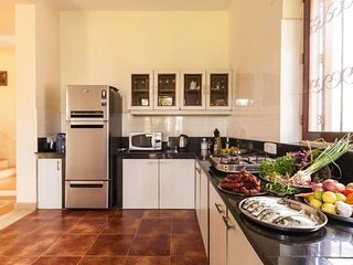 Open plan modern kitchen with freshly sourced local produce for the cook to prepare delicacies