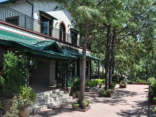 Facade view of the double-storied Vacation Home in Kasauli with large sundeck out front