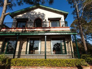 The front facade of this Vacation Villa in Kasauli overlooking the valley
