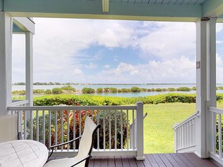 NEW LISTING! Two-story waterfront condo w/ patio, balconies & boating