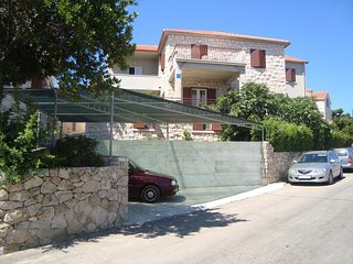 Two bedroom apartment Postira (Brac) (A-14902-a)