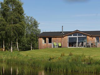 EXCLUSIVE luxury lodge in a secluded woodland setting with a steam room.