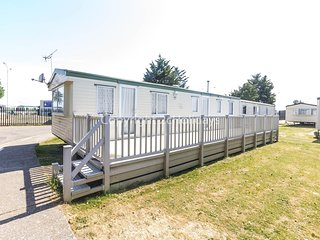 8 berth caravan with decking, close to park amenities. At Seawick. REF 27040