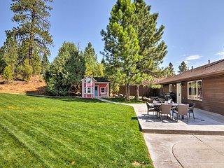 The family-friendly yard is complete with a playhouse and swing set!
