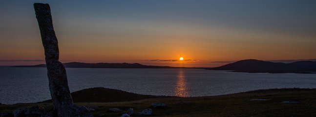 Sunset over Taransay from the Macleod Stone