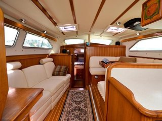 Bright, spacious, and luxurious galley that sleeps up to three adults