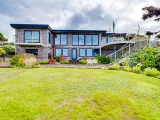 NEW LISTING! Exceptional oceanfront home w/game room, gourmet kitchen & views
