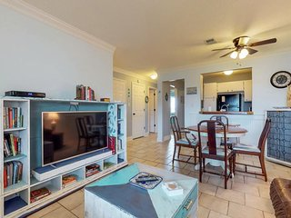 NEW LISTING! Cozy coastal condo with panoramic sound views and shared pools