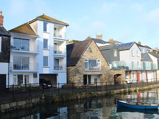 'St Keverne' (top floor) is on a tranquil harbourside quay