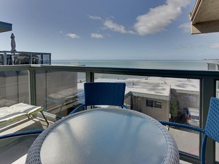 Ocean view condo w/ deck, balcony & shared pool - walk one block to the beach!