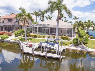 Spacious 4BR on Canal - Screened Deck w/ Heated Pool & Private Dock