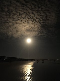 Night rocket launch from the beach
