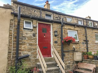 CROSLAND COTTAGE, character property, cosy base, close to village amenities and