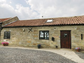 STABLES COTTAGE, woodburner, near Robin Hoods Bay