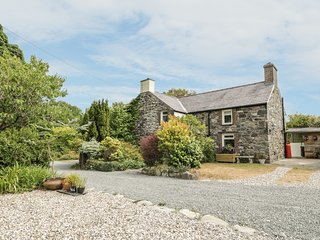 PLAS MAWR, stone farmhouse with exposed beams, Groeslon