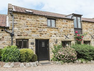 GRANARY COTTAGE, pet friendly, character holiday cottage, with a garden in