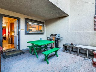 Walk to ski lifts from this charming condo with private hot tub