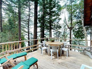 Rustic waterfront, dog-friendly cabin w/ mountain & lake views plus dock