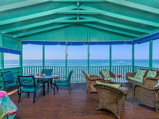 Sit on the veranda that literally hangs over the sea.