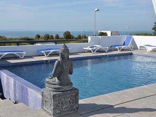 Modern holiday villa over the beach of Fontanilla