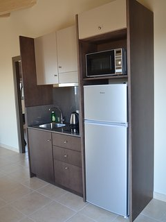 A compact kitchen is at your disposal