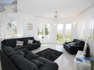 Light, spacious, comfortably furnished lounge with spectacular views towards mountains.