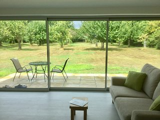 5 metre floor to ceiling glazed screen opens directly on to a beautiful organic orchard