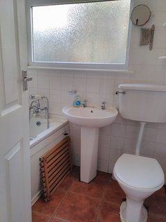 Bathroom with bath and shower over bath. Plenty of hot water.