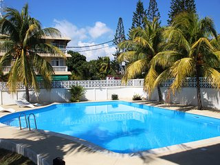 Apartment with pool close to beach, shops, bank