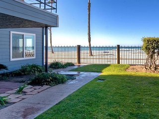 NEW LISTING! Beachfront condo with modern amenities, fireplace, and ocean views!