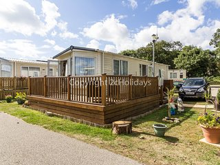 4 Berth caravan. D/G & C/H with decking and part seaview. Pets Welcome.Ref 32026