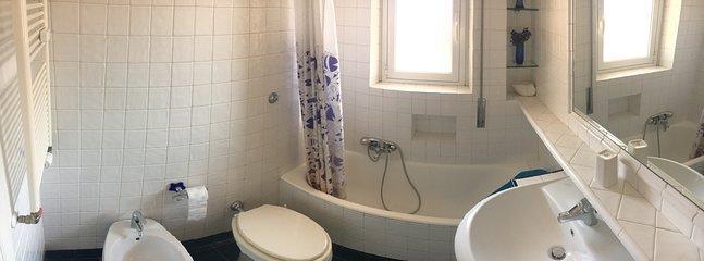 Bathroom 1: window opening onto terrace (bath and shower)