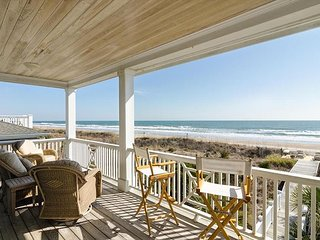 Watch the sunrise each morning in this oceanfront vacation home
