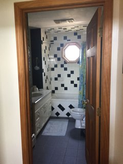 upstairs full bath with Jacuzzi tub and shower